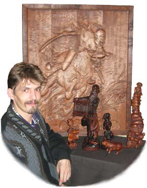 The master of woodcarving Victor Kaut. A wooden sculpture. Business vip souvenirs. Original elite gifts. Exclusive souvenirs. The Ukrainian subjects.